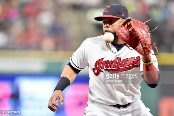 First baseman Carlos Santana of the Cleveland Indians fields a ground ball hit by Jorge Polanco of the Minnesota Twins during the third inning of the...