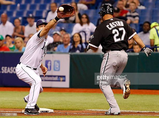 First baseman Casey Kotchman of the Tampa Bay Rays takes the throw to get catcher Ramon Castro of the Chicago White Sox during the game at Tropicana...