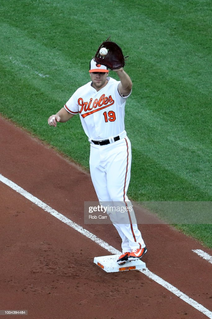 First baseman Chris Davis #19 of the Baltimore Orioles catches a ball for the second out of the first inning against the Boston Red Sox at Oriole Park at Camden Yards on July 23, 2018 in Baltimore, Maryland.