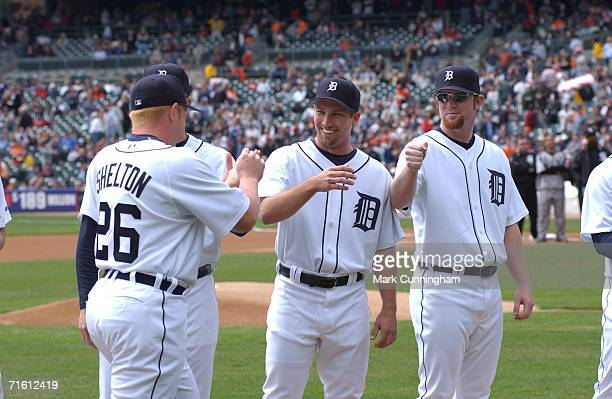 First Baseman Chris Shelton of the Detroit Tigers shakes hands with teammates Mike Maroth and Nate Robertson prior to the game against the Chicago...