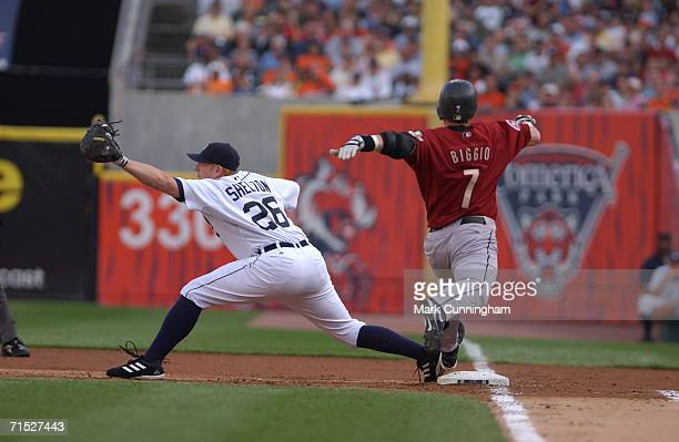 First Baseman Chris Shelton of the Detroit Tigers stretches for a throw on a close play as Houston Astro DH Craig Biggio is called out at first base...