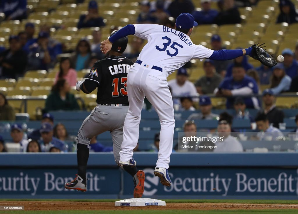 First baseman Cody Bellinger #35 of the Los Angeles Dodgers can't make the catch as Starlin Castro #13 of the Miami Marlins reaches first base safely in the eighth inning during the MLB game at Dodger Stadium on April 25, 2018 in Los Angeles, California. The Marlins defeated the Dodgers 8-6.