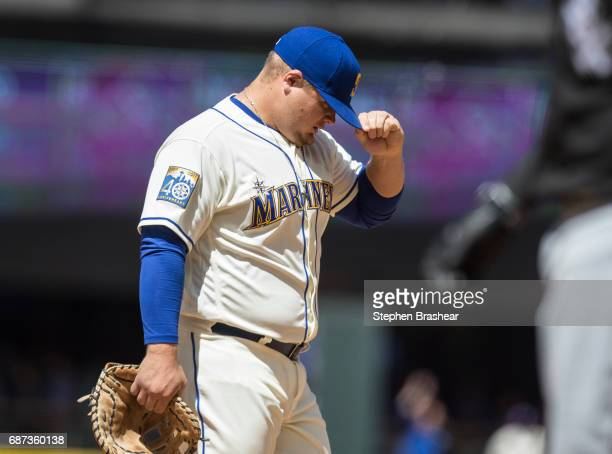 First baseman Dan Vogelbach of the Seattle Mariners adjust his hat between plays during a game against the Chicago White Sox at Safeco Field on May...