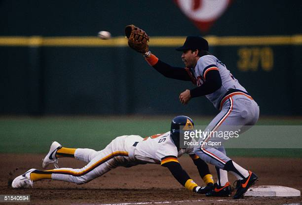 First baseman Dave Bergman of the Detroit Tigers reaches for the pickoff as Alan Wiggins of the San Diego Padres dives back to the bag during the...