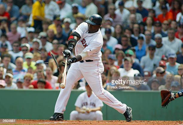 First baseman David Ortiz of the Boston Red Sox breakes his bat during the game against the New York Yankees at Fenway Park on August 30 2003 in...