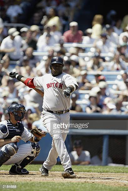 First baseman David Ortiz of the Boston Red Sox swings at the pitch during the game against the New York Yankees on July 6 2003 at Yankee Stadium in...