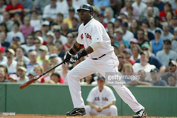 First baseman David Ortiz of the Boston Red Sox watches the hit during the game against the New York Yankees at Fenway Park on August 30 2003 in...
