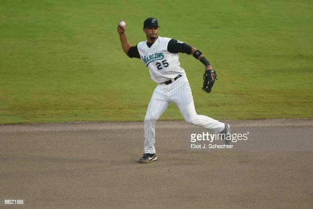 First Baseman Derrek Lee of the Florida Marlins throws the ball against the Detroit Tigers during the MLB game at Pro Player Stadium in Miami Florida...