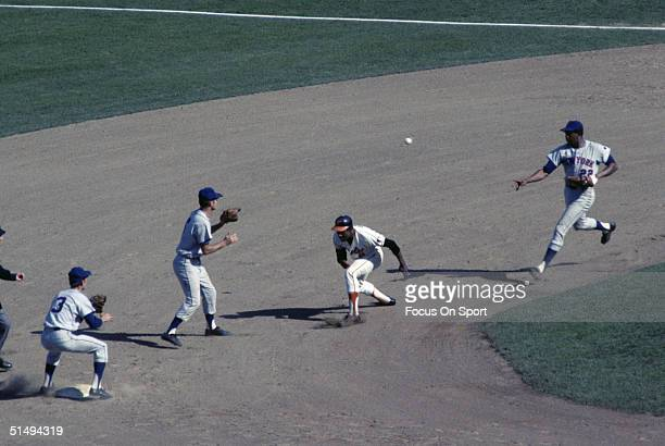 First baseman Donn Clendenon of the New York Mets flips to Al Weis of the Mets to nail Paul Blair of the Baltimore Orioles who was caught in the run...