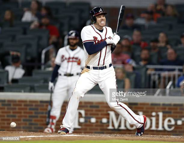 First baseman Freddie Freeman of the Atlanta Braves reacts after getting hit by a pitch in the eighth inning during the game against the Philadelphia...