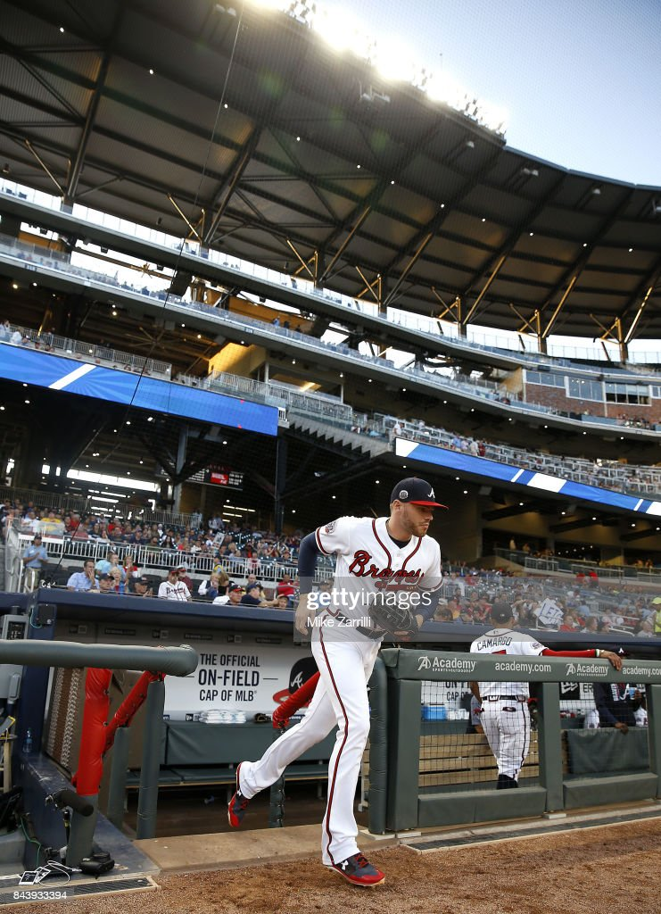 First baseman Freddie Freeman #5 of the Atlanta Braves runs on to the field in the beginning of the game against the Miami Marlins at SunTrust Park on September 7, 2017 in Atlanta, Georgia.