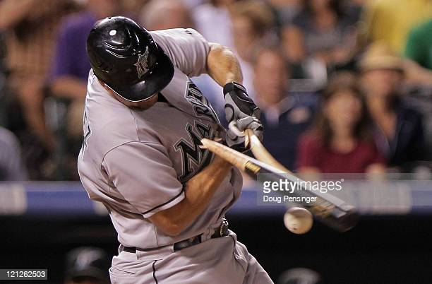 First baseman Gaby Sanchez of the Florida Marlins breaks his bat on a foul ball off of relief pitcher Edgmer Escalona of the Colorado Rockies in the...