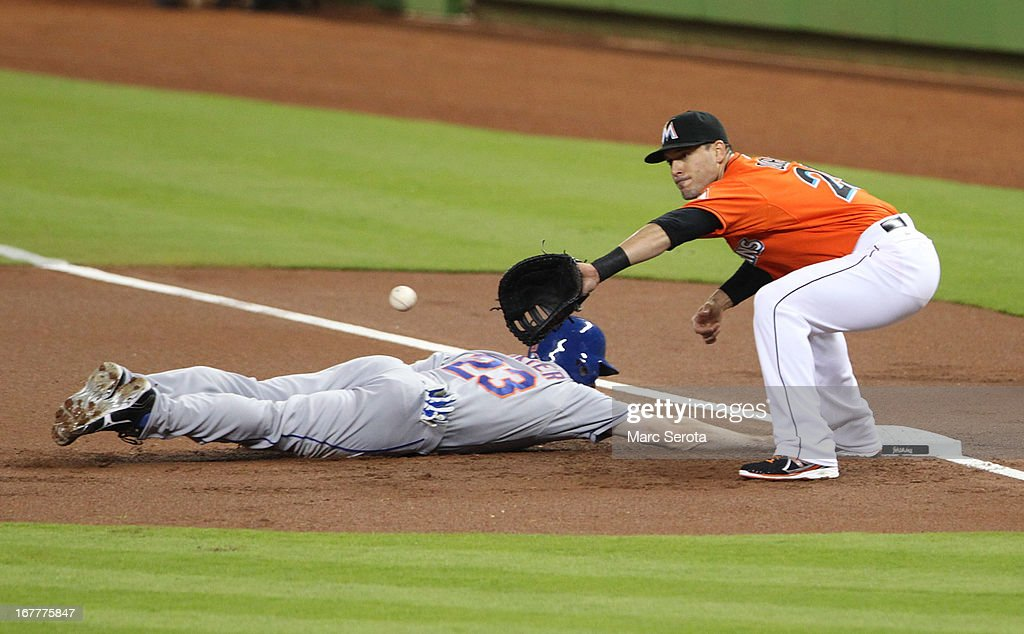 First baseman Greg Dobbs #29 of the Miami Marlins attempts to pick off Mike Baxter #23 of the New York Mets in the second inning at Marlins Park on April 29, 2013 in Miami, Florida.