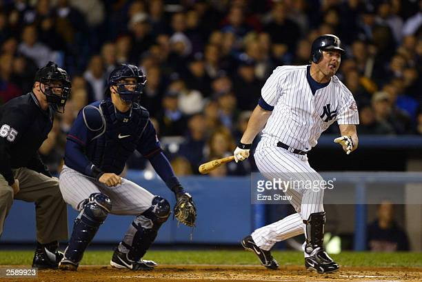 First baseman Jason Giambi of the New York Yankees connects with a Minnesota Twins pitch during game two of the American League Division Series at...