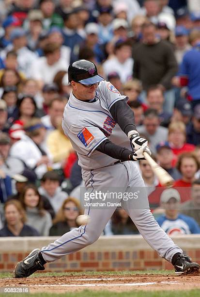 First baseman Jason Phillips of the New York Mets at bat during the game against the Chicago Cubs on April 25, 2004 at Wrigley Field in Chicago,...