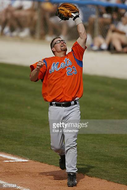 First baseman Jason Phillips of the New York Mets gets ready to catch a fly ball in the Spring Training game against the Los Angeles Dodgers on March...