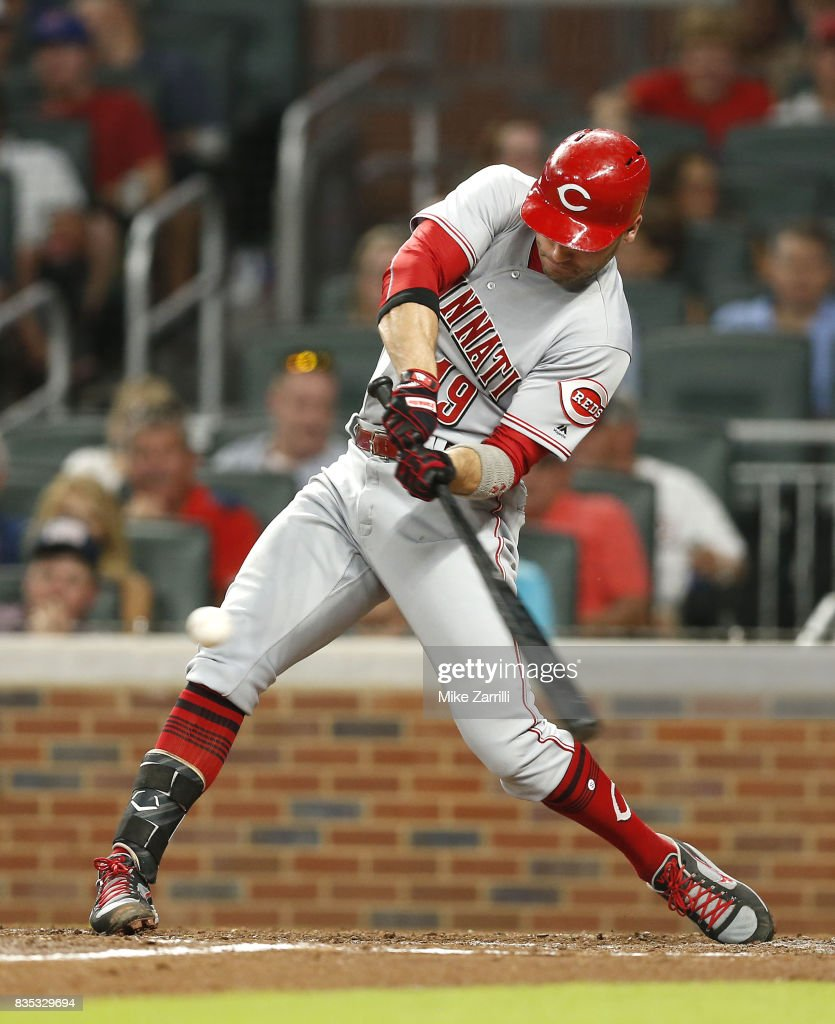 First baseman Joey Votto #19 of the Cincinnati Reds hits a single in the sixth inning during the game against the Atlanta Braves at SunTrust Park on August 18, 2017 in Atlanta, Georgia.