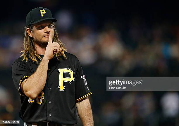First baseman John Jaso of the Pittsburgh Pirates gestures to the fans in the eighth inning during a game against the New York Mets at Citi Field on...