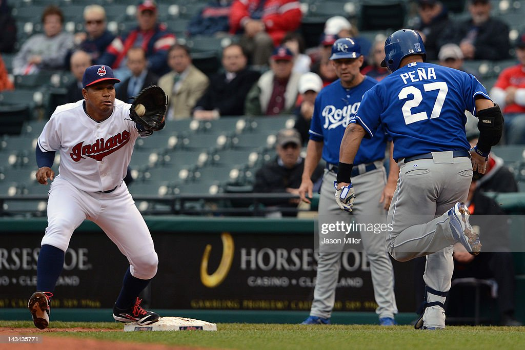 First baseman Jose Lopez #4 of the Cleveland Indians makes the catch at first to force out Brayan Pena #27 of the Kansas City Royals during the second inning at Progressive Field on April 26, 2012 in Cleveland, Ohio.