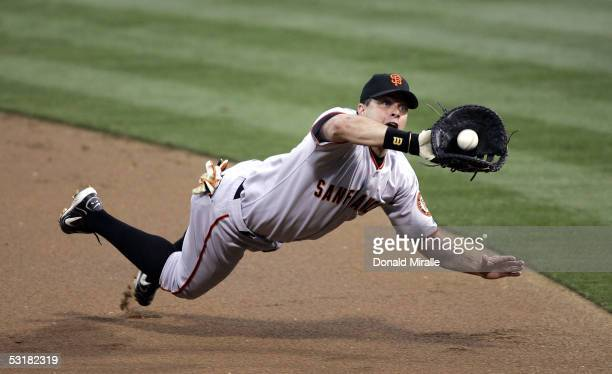 First baseman JT Snow of the San Francisco Giants tries to catch a line drive hit by Xavier Nady of the San Diego Padres in the first inning on July...