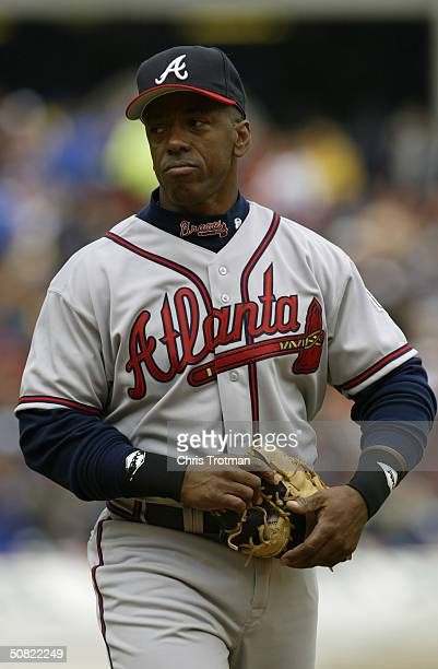 First baseman Julio Franco of the Atlanta Braves walks out to the field during the game against the New York Mets at Shea Stadium on April 12 2004 in...
