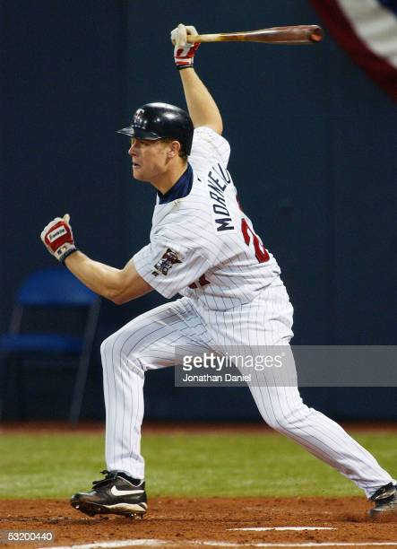 First baseman Justin Morneau of the Minnesota Twins bats during game three of the American League Divisional Series with the New York Yankees at the...