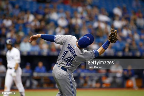First baseman Justin Smoak of the Toronto Blue Jays hauls in the foul ball by Evan Longoria of the Tampa Bay Rays to end the fourth inning of a game...