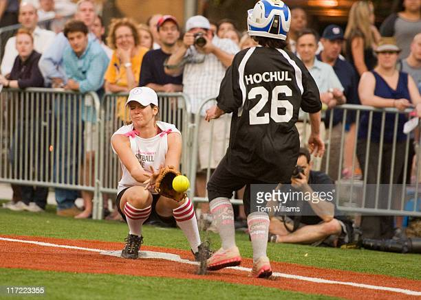 First baseman Kasie Hunt of Politico collides with runner Rep Kathy Hochul DNY during the third annual Congressional Women's Softball game held at...