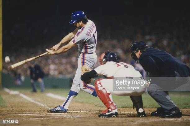 First baseman Keith Hernandez of the New York Mets makes contact with the ball during the World Series against the Boston Red Sox at Fenway Park on...