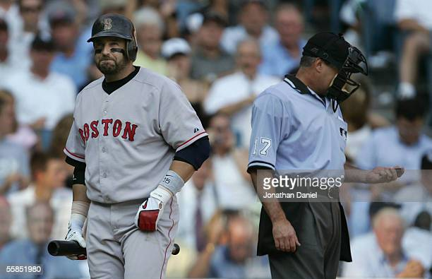 First baseman Kevin Millar of the Boston Red Sox reacts to home plate umpire John Hirschbeck after being called out on strikes against the Chicago...