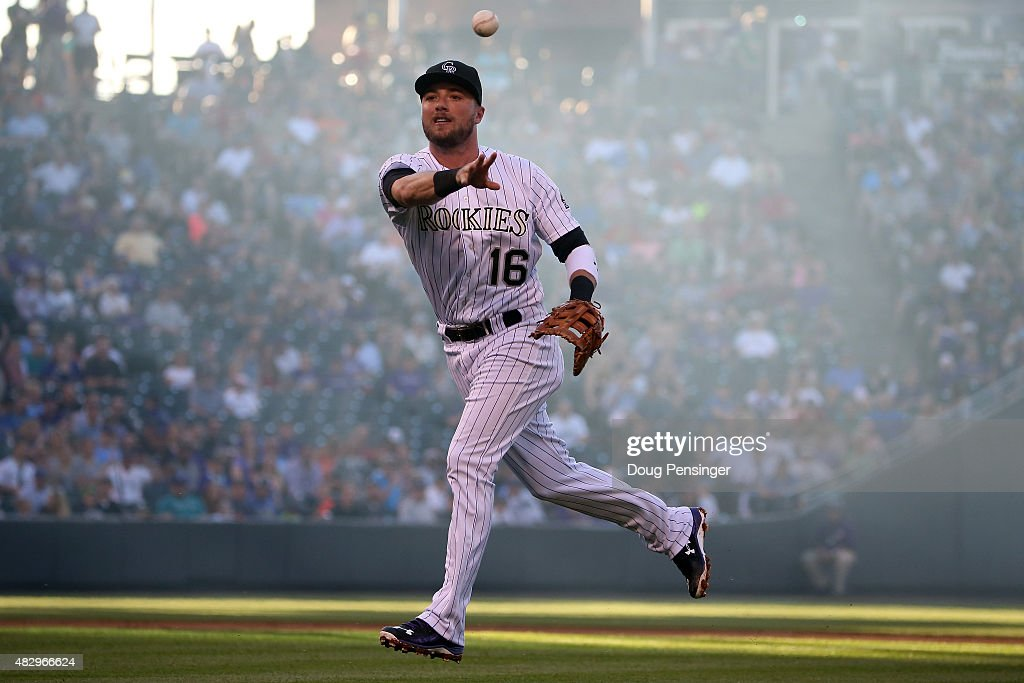First baseman Kyle Parker #16 of the Colorado Rockies earns an assist as he fields a ground ball by Vidal Nuno #38 of the Seattle Mariners and tosses it to pitcher Jon Gray #55 of the Colorado Rockies for a put out to end the second inning during interleague play at Coors Field on August 4, 2015 in Denver, Colorado.