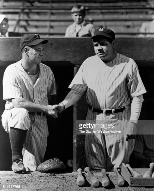 First baseman Lou Gehrig of the New York Yankees shakes hands with teammate Babe Ruth circa 1925