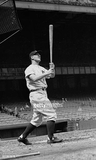 First baseman Lou Gehrig of the New York Yankees watches the flight of a drive to right field during batting practice prior to a 1937 season game at...
