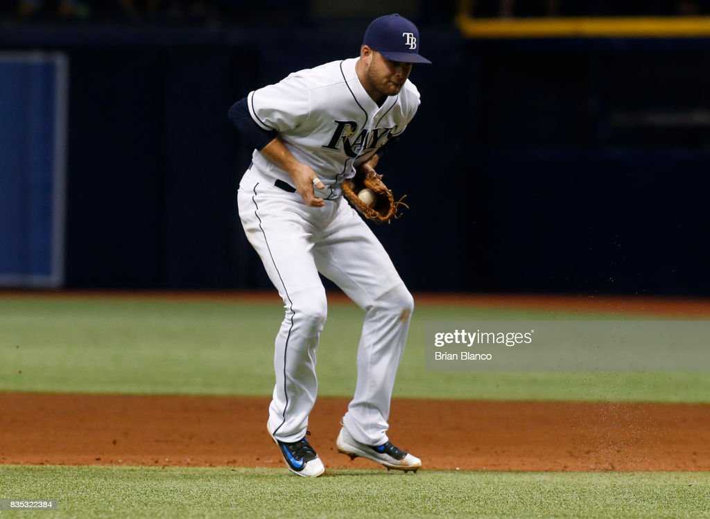 First baseman Lucas Duda #21 of the Tampa Bay Rays hauls in the ground ball by Yonder Alonso of the Seattle Mariners then starts off the double play with the throw to shortstop Adeiny Hechavarria to end the top of the fourth inning of a game on August 18, 2017 at Tropicana Field in St. Petersburg, Florida.