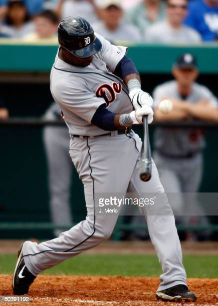 First baseman Marcus Thames of the Detroit Tigers gets into a pitch against the Pittsburgh Pirates during the Grapefruit League Spring Training game...