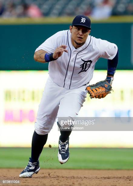 First baseman Miguel Cabrera of the Detroit Tigers runs to first base to make an out on Logan Morrison of the Minnesota Twins during the third inning...