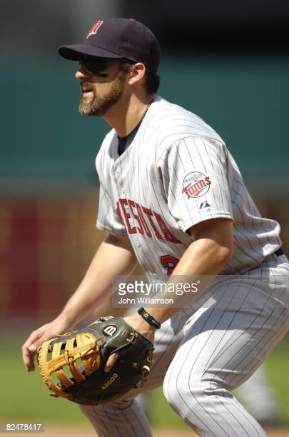 First baseman Mike Lamb of the Minnesota Twins looks to home plate for the pitch from his position in the field during the game against the Kansas...