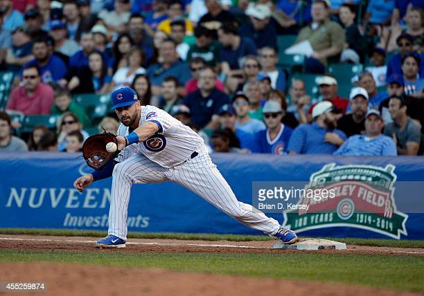 First baseman Mike Olt of the Chicago Cubs catches the ball during the fifth inning against the Pittsburgh Pirates at Wrigley Field on September 6...