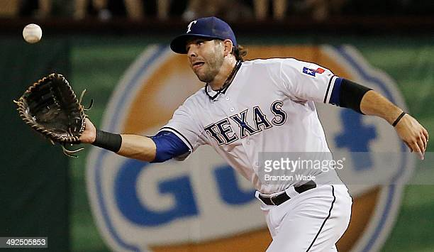 First baseman Mitch Moreland of the Texas Rangers catches a ball off the bat of Brad Miller of the Seattle Mariners during the eighth inning of a...