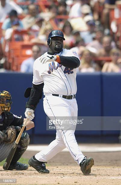 First baseman Mo Vaughn of the New York Mets swings at the pitch during the MLB game against the Arizona Diamondbacks on August 4, 2002 at Shea...