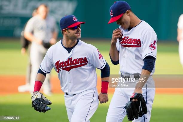 First baseman Nick Swisher talks to starting pitcher Ubaldo Jimenez of the Cleveland Indians after Jimenez caught a line drive off the bat of Kendrys...