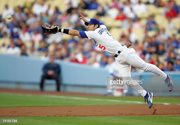 First baseman Nomar Garciaparra of the Los Angeles Dodgers dives but can't come up with an eventual single by Chris Duncan of the St. Louis Cardinals...