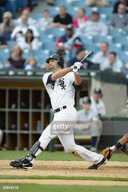 First baseman Paul Konerko of the Chicago White Sox hits a two run home run off of Bob Wickman in the ninth inning during the game against the...