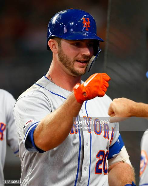 First baseman Pete Alonso of the New York Mets is congratulated in the dugout after hitting a 2run home run in the seventh inning during the game...