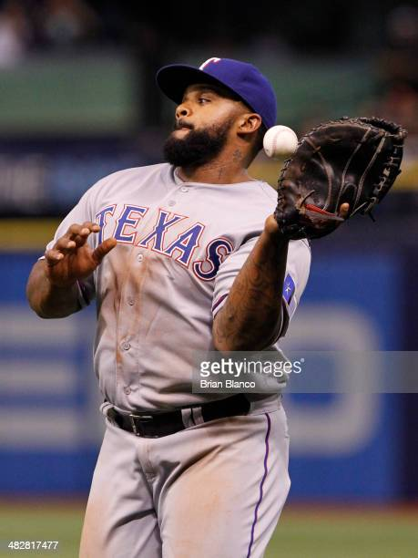 First baseman Prince Fielder of the Texas Rangers fails to haul in a pop foul by Brandon Guyer of the Tampa Bay Rays during the fifth inning of a...