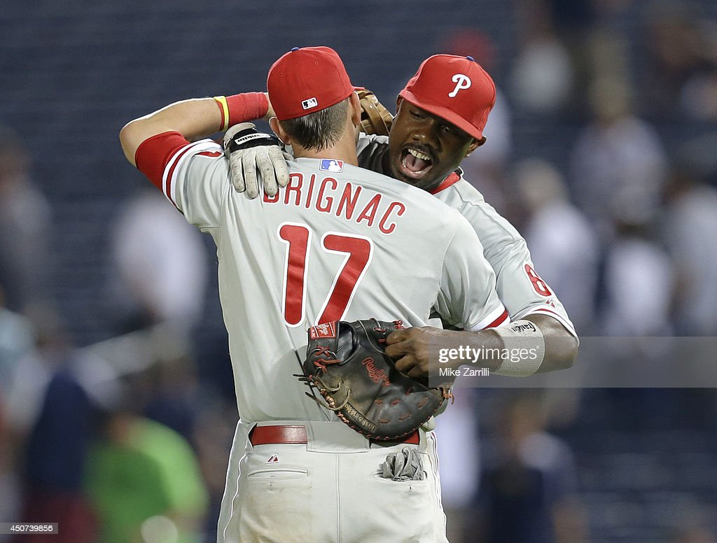 First baseman Ryan Howard #6 of the Philadelphia Phillies celebrates with third baseman Reid Brignac #17 after the game against the Atlanta Braves at Turner Field on June 16, 2014 in Atlanta, Georgia.