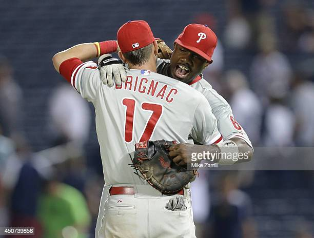 First baseman Ryan Howard of the Philadelphia Phillies celebrates with third baseman Reid Brignac after the game against the Atlanta Braves at Turner...