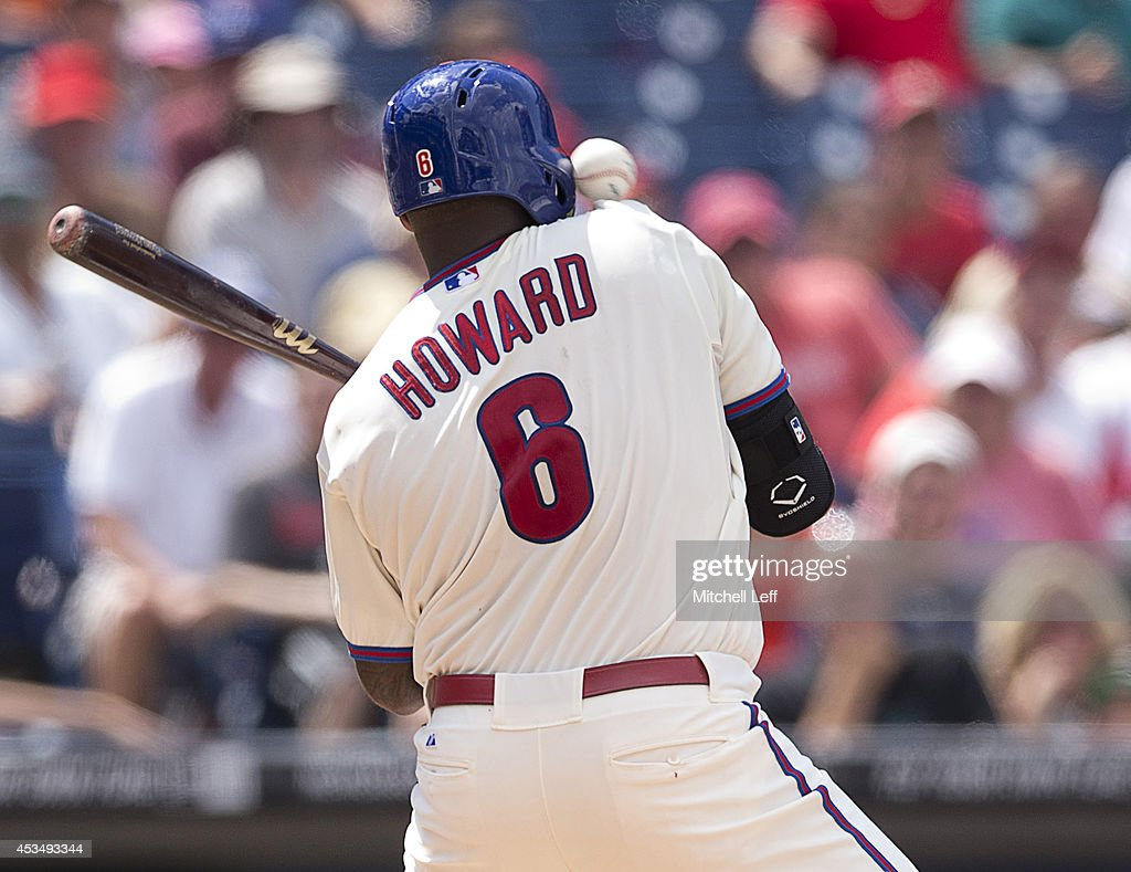 First baseman Ryan Howard #6 of the Philadelphia Phillies is hit by a pitch in the bottom of the sixth inning against the New York Mets on August 11, 2014 at Citizens Bank Park in Philadelphia, Pennsylvania.
