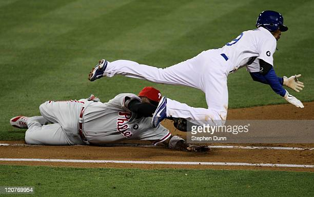 First baseman Ryan Howard of the Philadelphia Phillies tags out Dee Gordon of the Los Angeles Dodgers after fielding Gordon's bunt on August 9 2011...