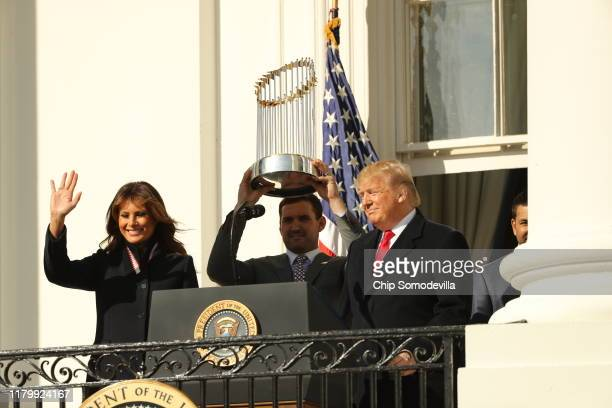 First baseman Ryan Zimmerman holds up the Commissioner's Trophy as US President Donald Trump and first lady Melania Trump welcome the 2019 World...